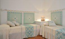 Schlafzimmer mit zwei Einzelbetten Li Conchi 10, Cala Sinzias