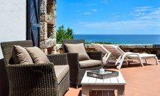 Sant Elmo Terrasse mit Sofa, Sonnenliegen und Meerblick, Casa 24